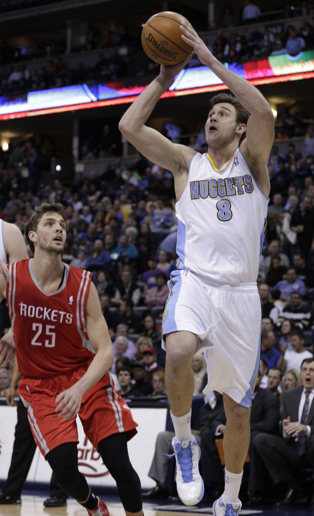 Denver Nuggets forward Danilo Gallinari (8) shoots against Houston Rockets forward Chandler Parsons (25) during the fourth quarter of an NBA basketball game, Wednesday, Jan. 30, 2013, in Denver. Denver won 118-110. (AP Photo/Joe Mahoney)