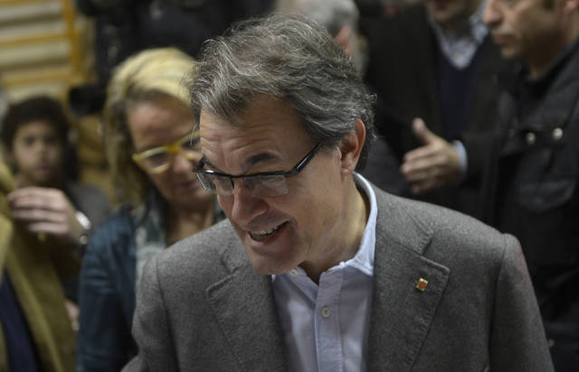 The leader of center-right Catalan Nationalist Coalition (CiU), Artur Mas smiles after casting his vote during elections for the 'Generalitat de Catalunya' (Catalan Autonomous Government) in Barcelona, Sunday, Nov. 25, 2012. Voters in Catalonia begin casting their ballots in regional elections that could determine the future shape of Spain. If voters give the regional government strong support, its leader pledged to hold a referendum asking Catalans if they'd prefer to split from Spain and go it alone in the 27-member EU. (AP Photo/Manu Fernandez)
