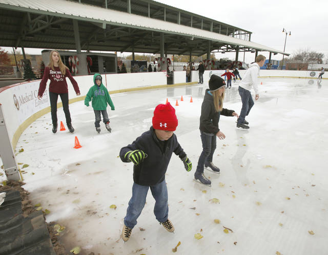 Children and their parents enjoy a new outdoor skating rink at Edmond's Festival Market Place in Edmond, OK, Friday, Nov. 25, 2011. By Paul Hellstern, The Oklahoman