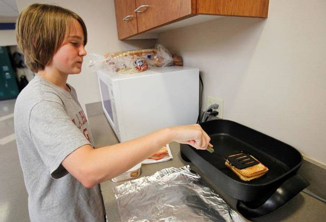 Westminster School  student Sam Hill, 7th grade makes a grilled-cheese sandwich during lunch hour in Oklahoma City, Tuesday, May  8,  2012. Photo By Steve Gooch, The Oklahoman <strong>Steve Gooch - The Oklahoman</strong>