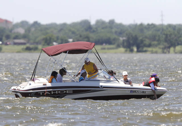 In this photo from earlier this month, boaters enjoy the warm air and cool water at Lake Hefner, which is full again. (The Oklahoman,  Paul Hellstern)