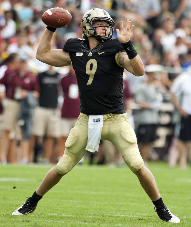 Purdue quarterback Robert Marve throws the ball against Eastern Kentucky during an NCAA college football game, Saturday, Sept. 1, 2012, in West Lafayette, Ind. Purdue won 48-6. (AP Photo/The Journal & Courier, Brent Drinkut) MANDATORY CREDIT; NO SALES