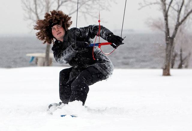 WINTER STORM / SNOW STORM: Chris Roberts is pulled by a power kite on a snowboard at Lake Hefner during a winter storm in Oklahoma City, Friday, January 29, 2010. Photo by Nate Billings, The Oklahoman