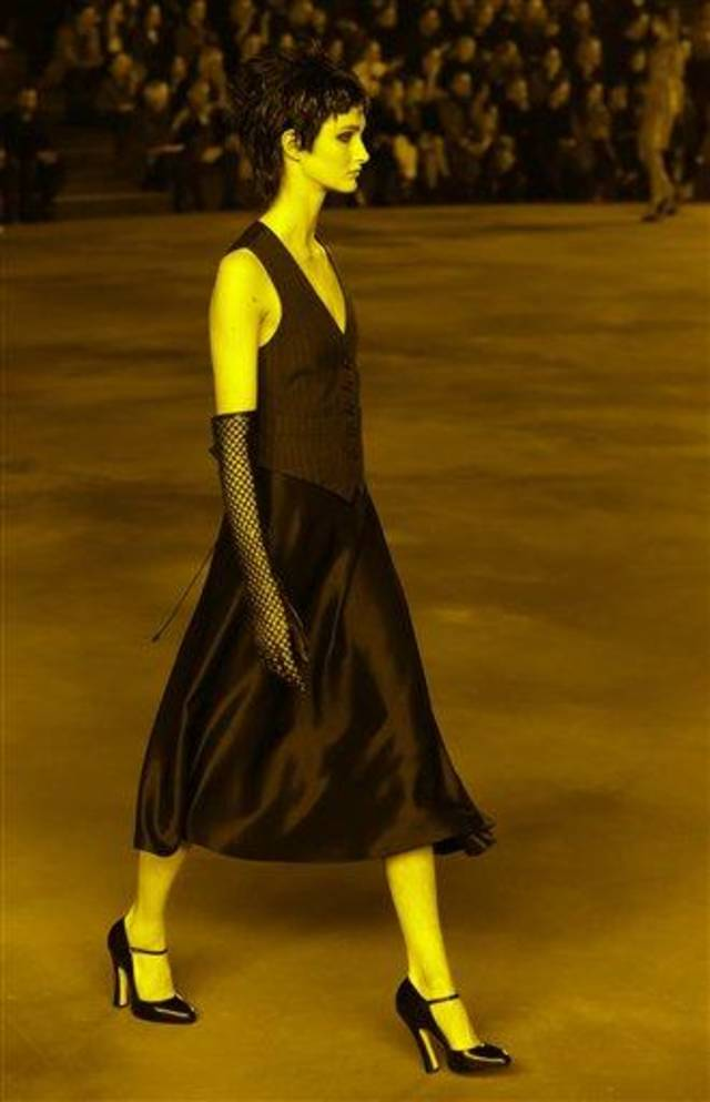 A model appears in sepia-toned light during the Marc Jacobs Fall 2013 fashion show Fashion Week in New York, Thursday, Feb. 14, 2013.  (AP Photo/Kathy Willens)