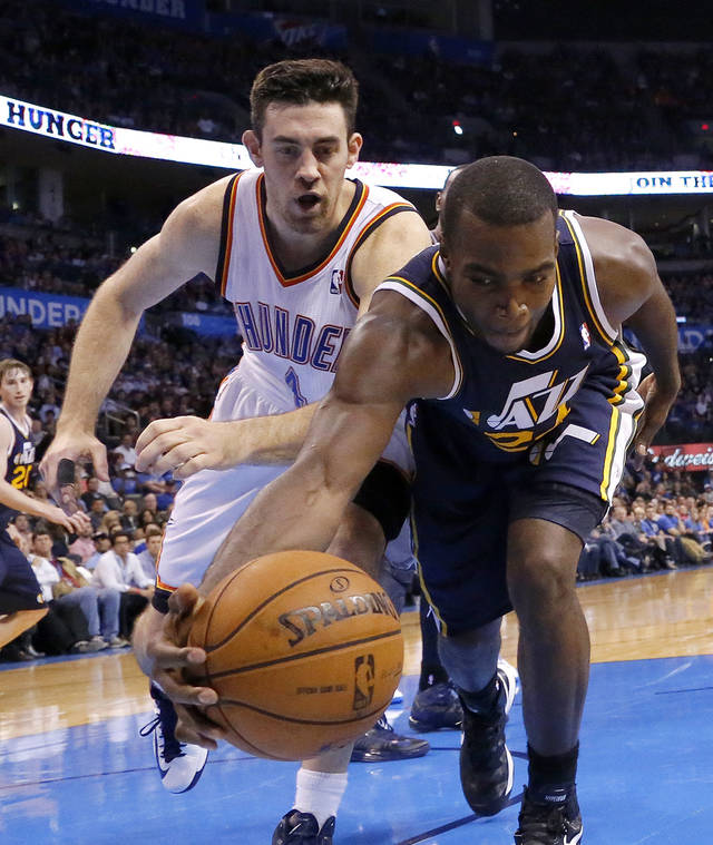 Utah's Al Jefferson (25) and Oklahoma City's Nick Collison (4) try to save a ball during the NBA game between the Oklahoma City and the Utah Jazz and the Chesapeake Energy Arena, Friday,Nov. 30, 2012. Photo by Sarah Phipps, The Oklahoman