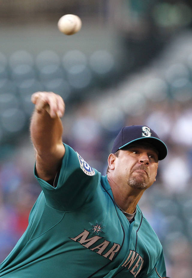 Seattle Mariners starting pitcher Kevin Millwood throws to a Los Angeles Dodgers batter in the second inning of a baseball game Friday, June 8, 2012, in Seattle. (AP Photo/Elaine Thompson)