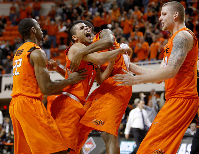 NIT SEASON TIP-OFF TOURNAMENT / CELEBRATION: Oklahoma State's Cezar Guerrero, center, celebrates with Markel Brown, left, Michael Cobbins, and Philip Jurick, right, after winning an NCAA college basketball game between the Oklahoma State University Cowboys (OSU) and the University of Texas-San Antonio Roadrunners at Gallagher-Iba Arena in Stillwater, Okla., Wednesday, Nov. 16, 2011. Photo by Bryan Terry, The Oklahoman ORG XMIT: KOD