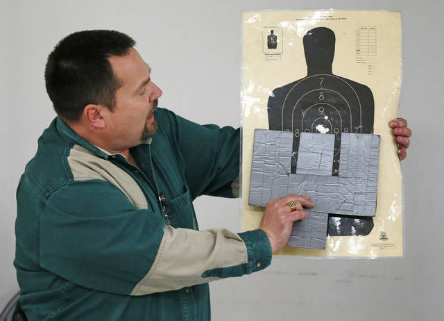 Left and above: Will Andrews, training coordinator at H&H Shooting Sports Complex, teaches about using the sights on a handgun and the stance to use when firing a handgun during a concealed-carry class Wednesday at the gun range in Oklahoma City.