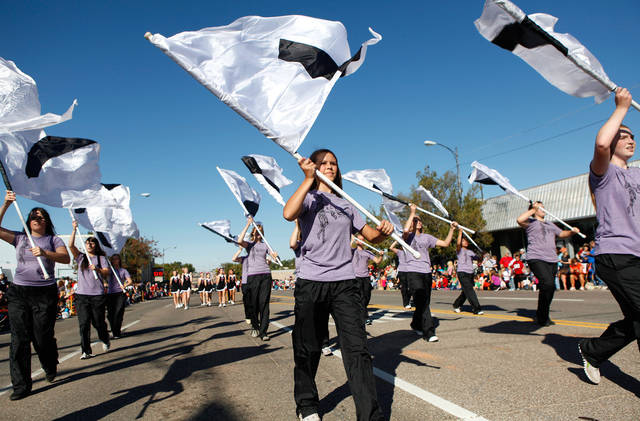 Yukon High School Color Guard performs with the school's marching band. Pleasant temperatures and a deep blue sky  provided a perfect setting for Yukon's 46th annual Oklahoma Czech Festival  Saturday, Oct. 1, 2011.  Thousands of visitors crammed downtown streets to watch the morning parade, eat authentic Czech foods,listen and dance to  music played by polka bands, and buy  fruit-filled kolaches by the dozens. Photo by Jim Beckel, The Oklahoman