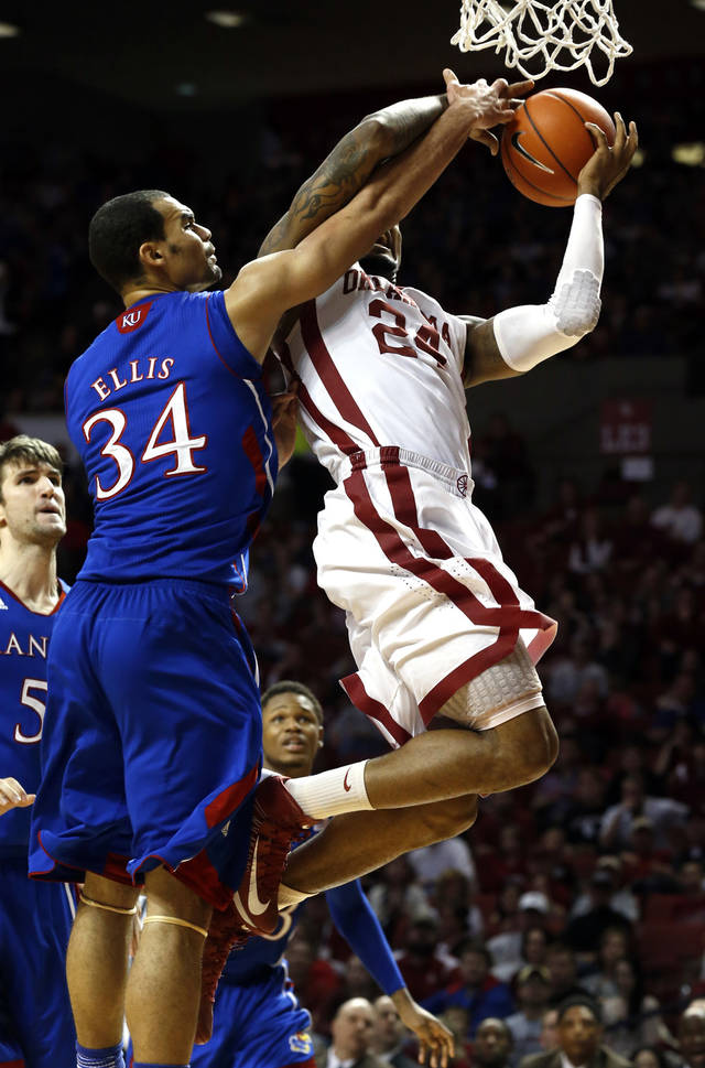 Oklahoma's Romero Osby (24) is fouled o a shot by Kansas' Perry Ellis (34) during the second half as the University of Oklahoma Sooners (OU) defeat the Kansas Jayhawks (KU) 72-66 in NCAA, men's college basketball at The Lloyd Noble Center on Saturday, Feb. 9, 2013 in Norman, Okla. Photo by Steve Sisney, The Oklahoman