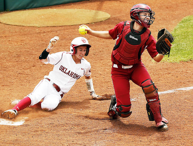Brianna Turang, left, uses her speed to give Oklahoma's offense a different dimension. Photo by Steve Sisney, The Oklahoman