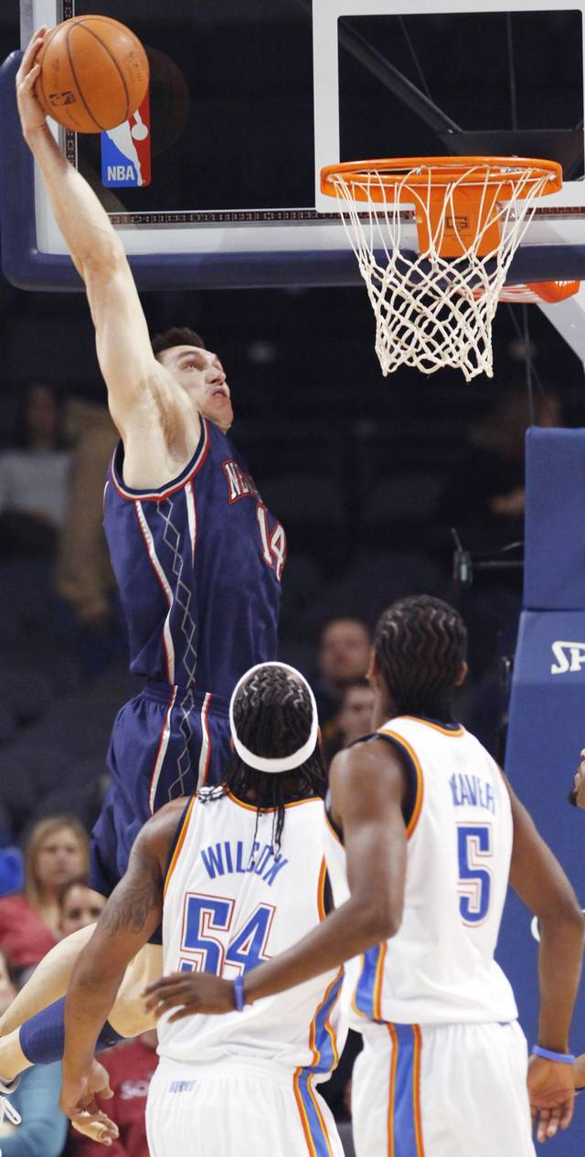 New Jersey's Eduardo Najera goes up for a dunk during Monday's game between the Nets and the Thunder. Najera, who played in college at Oklahoma and lives in Edmond, said his NBA career has been everything he has hoped for. Ap photo