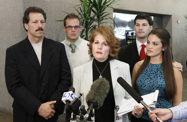 Vicki Behenna, center, mother of 1st Lt. Michael Behenna, is joined by her husband left, Scott Behenna and their sons Curtis and Brett Behenna and his wife Kirby as they talk with reporters in Oklahoma City, Friday, July 6, 2012. Lt. Behenna was charged in 2009 with unpremeditated murder  in a combat zone and sentenced to 15 years of confinement at Fort Leavenworth, Kansas.  Photo By Steve Gooch, The Oklahoman