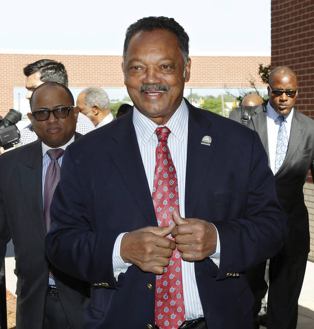 Rev. Jesse Jackson arrives for his visit to  Douglass High School in Oklahoma City on Wednesday morning, April 18, 2012.   Jackson held a brief, informal session with players from the school's state championship basketball team before addressing a general assembly of students in the auditorium. His comments were of an inspirational nature, encouraging the youth to stay in school and  focus on their academic  requirements so they can have more access to opportunities  for success and advancement in life after graduation.    Photo by Jim Beckel, The Oklahoman