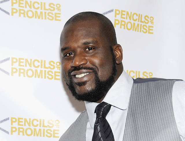 "FILE - This Nov. 17, 2011 file photo shows Shaquille O'Neal at the ""Pencils Of Promise"" inaugural gala in New York. O'Neal is providing a forum for comics for his �All Star Comedy Jam"" tour.  The twenty-city tour includes urban comics Kevin Hart, Finesse Mitchell, and Gary Owen. The tour ends on New Year's Eve in Atlanta.  (AP Photo/Evan Agostini, file)"