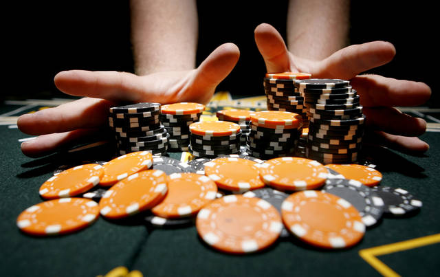 OKLAHOMA STATE UNIVERSITY COWBOYS FOOTBALL, POKER CHIPS: Photo illustration for OSU Pregame package.  BY BRYAN TERRY, THE OKLAHOMAN ORG XMIT: KOD