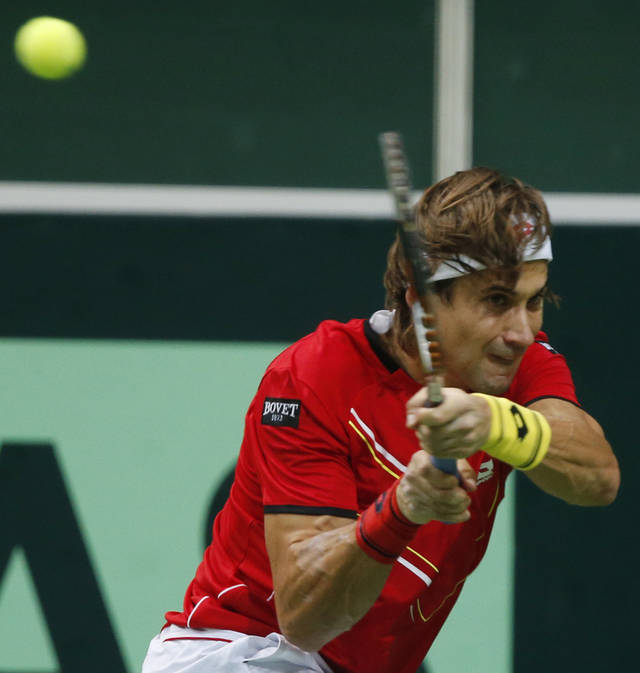 Spain's David Ferrer returns a ball to Czech Republic's Tomas Berdych during their Davis Cup finals tennis match in Prague, Czech Republic, Sunday, Nov. 18, 2012. (AP Photo/Petr David Josek)