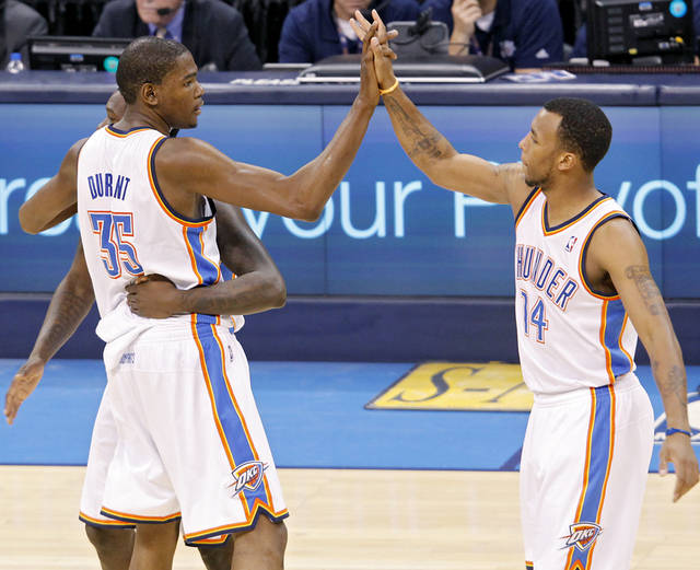 Kevin Durant celebrates with Daequan Cook (right) and Royal Ivey (partially hidden) as Durant leaves the game during the fourth quarter of game 7 of the NBA basketball Western Conference semifinals between the Memphis Grizzlies and the Oklahoma City Thunder at the OKC Arena in Oklahoma City, Sunday, May 15, 2011. The Thunder beat the Grizzlies 105-90 to advance to the Western Conference finals against Dallas. Photo by John Clanton, The Oklahoman