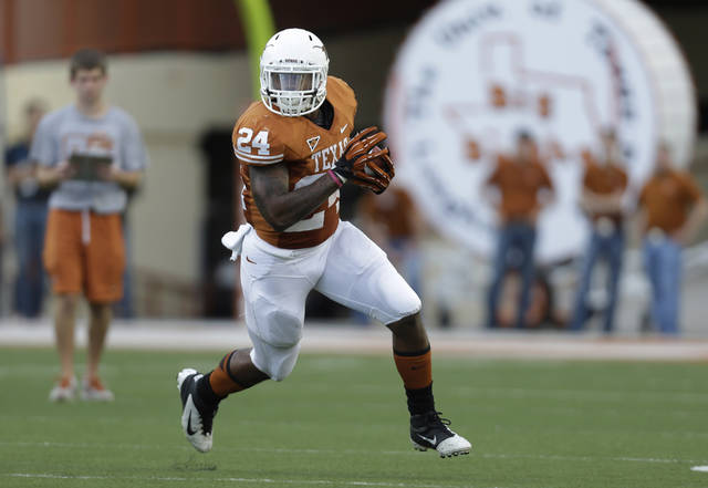Texas' Joe Bergeron runs during the NCAA college football team's spring game, Saturday, March 30, 2013, in Austin, Texas. (AP Photo/Eric Gay)