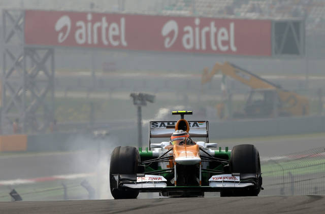 Force India driver Nico Hulkenberg of Germany locks a wheel during the third practice session for the Indian Formula One Grand Prix, at the Buddh International Circuit in Noida, on the outskirts of New Delhi, India, Saturday, Oct. 27, 2012. (AP Photo/Greg Baker)