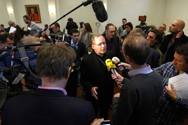 "Archbishop of Utrecht Wim Eijk, center, answers questions during a press conference in Zeist, Netherlands, Friday, Dec. 16, 2011. A Dutch archbishop has apologized to victims after an independent inquiry reported that thousands of children suffered sexual abuse in Catholic institutions, and church officials knew about it but failed to adequately address it. Wim Eijk says the report ""fills us with shame and sorrow."" (AP Photo/Bas Czerwinski)"