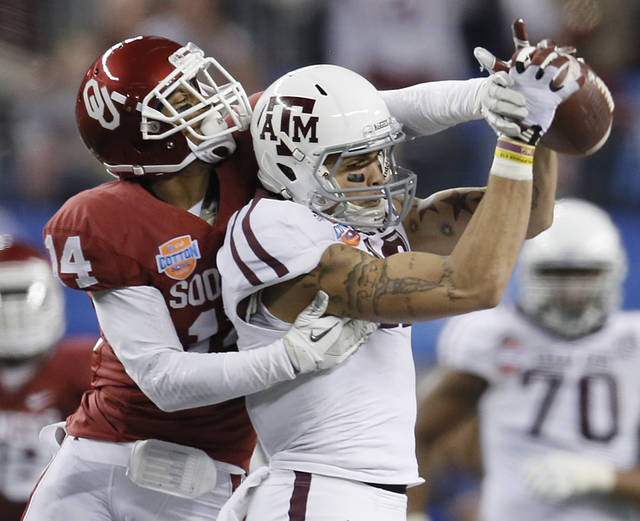 Texas A&M�s Mike Evans, right, makes a catch in front of Oklahoma�s Aaron Colvin during the Cotton Bowl. Colvin announced Monday he will be back next season for Oklahoma, instead of entering the NFL Draft. Photo by Chris Landsberger, The Oklahoman