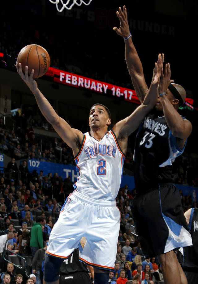 Oklahoma City's Thabo Sefolosha (2) goes past Minnesota's Dante Cunningham (33) during an NBA basketball game between the Oklahoma City Thunder and the Minnesota Timberwolves at Chesapeake Energy Arena in Oklahoma City, Wednesday, Jan. 9, 2013.  Photo by Bryan Terry, The Oklahoman