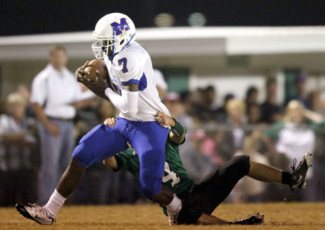 Millwood quarterback Kevonte Richardson is brought down by Jones' Chris Humphrey during the high school football game between Jones and Millwood, Friday, Oct. 08, 2010, at Jones High School in Jones, Okla. Photo by Sarah Phipps, The Oklahoman