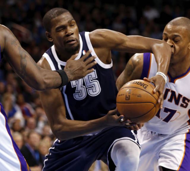 Oklahoma City Thunder's Kevin Durant (35) drives past Phoenix Suns' P.J. Tucker (17) as the Oklahoma City Thunder play the Phoenix Suns in NBA basketball at the Chesapeake Energy Arena in Oklahoma City, on Monday, Dec. 31, 2012.  Photo by Steve Sisney, The Oklahoman