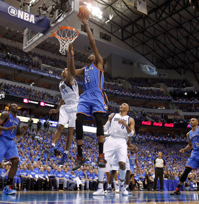Oklahoma City's Kevin Durant (35) goes to the basket between Dallas' Brandan Wright (34) and Shawn Marion (0) during Game 3 of the first round in the NBA playoffs between the Oklahoma City Thunder and the Dallas Mavericks at American Airlines Center in Dallas, Thursday, May 3, 2012. Photo by Bryan Terry, The Oklahoman