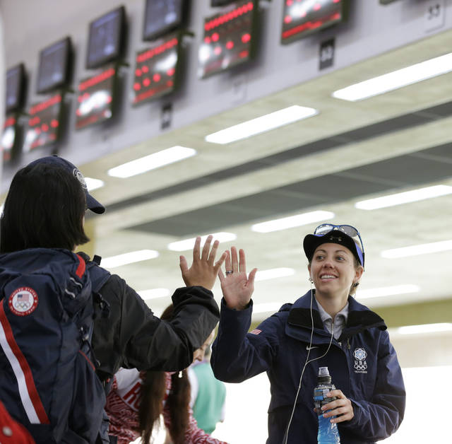 United States of America's Jamie Lynn Gray, right, gets a high five after breaking the Olympic qualifying record in the women's 50-meter rifle 3 positions event, at the 2012 Summer Olympics, Saturday, Aug. 4, 2012, in London. (AP Photo/Rebecca Blackwell)