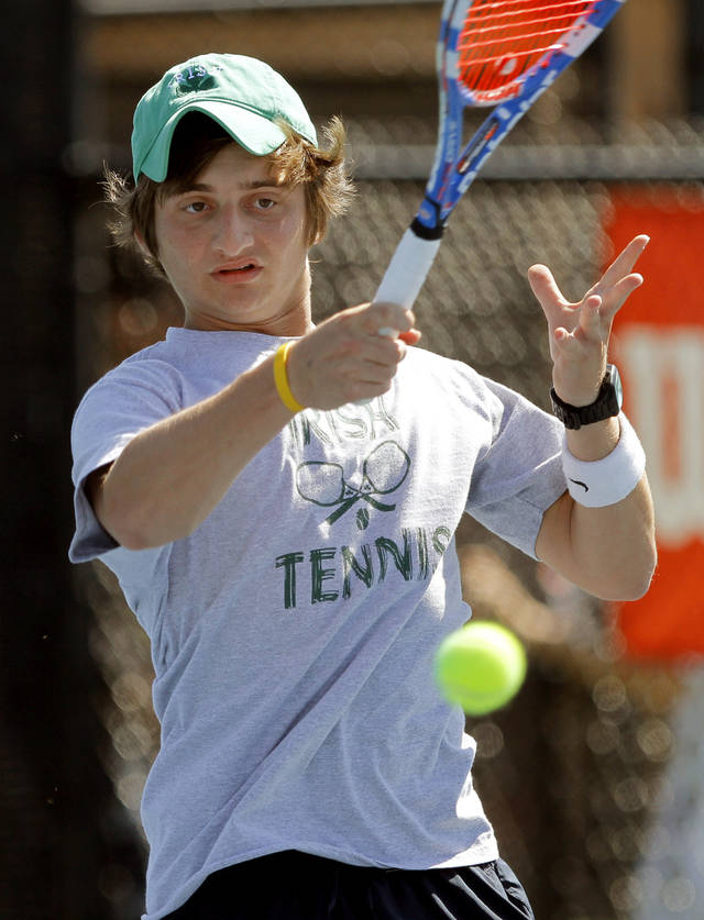 Jonathan Kraft of Bishop McGuiness  plays in the class 5A #2 singles match of the state tennis tournament at the Oklahoma City Tennis Center, Saturday, May14, 2011. Photo by Bryan Terry, The Oklahoman