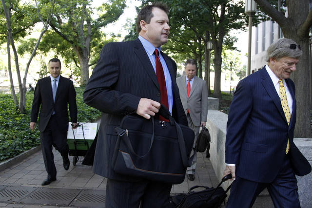 Former Major League Baseball pitcher Roger Clemens, center, follows his attorney Rusty Hardin, right, as they arrive at federal court in Washington, Thursday, May 24, 2012. Attorney Michael Attanasio is at left. (AP Photo/Charles Dharapak)
