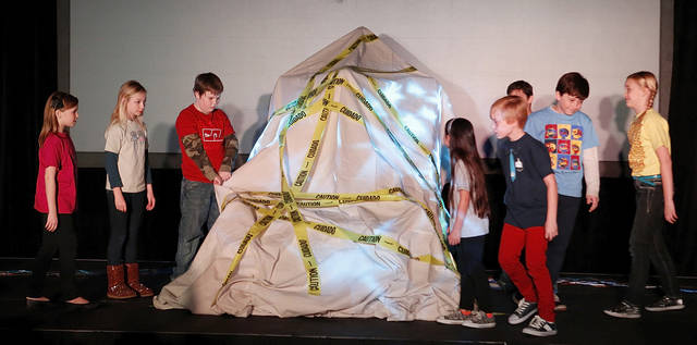 A group of children prepare to unveil a giant switch at Science Museum Oklahoma during a program to announce plans to create a 21,000-square-foot exhibit focusing on children ages 3 to 6 with funding from a $12 million grant from the Donald W. Reynolds Foundation in Oklahoma City, Tuesday  January  22, 2013. Photo By Steve Gooch, The Oklahoman