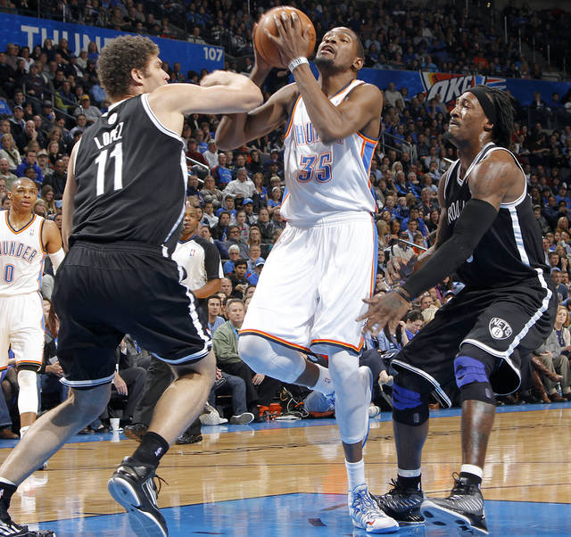Oklahoma City&#039;s Kevin Durant (35) drives to the basket past Brooklyn Nets&#039; Brook Lopez (11) and Gerald Wallace (45) during the NBA basketball game between the Oklahoma City Thunder and the Brooklyn Nets at the Chesapeake Energy Arena on Wednesday, Jan. 2, 2013, in Oklahoma City, Okla. Photo by Chris Landsberger, The Oklahoman