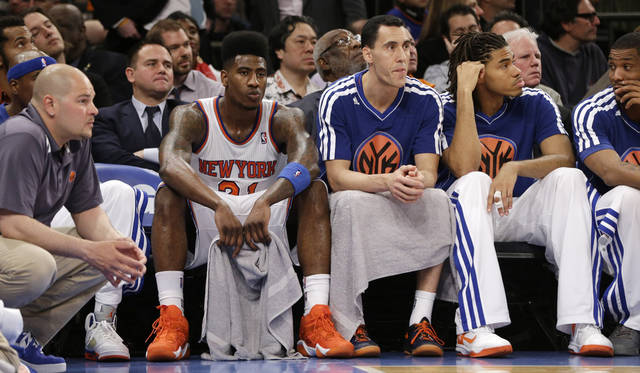 New York Knicks forward Iman Shumpert (21), guard Pablo Prigioni and forward Chris Copeland (14) react on the bench in the second half of Game 5 of their first-round NBA basketball playoff series against the Boston Celtics at Madison Square Garden in New York, Wednesday, May 1, 2013. The Celtics won 92-86. (AP Photo/Kathy Willens)