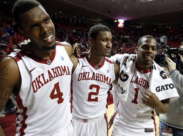 Oklahoma's Andrew Fitzgerald (4), Steven Pledger (2) and Sam Grooms (1) leave the court as the University of Oklahoma Sooners (OU) defeat the Kansas Jayhawks (KU) 72-66 in NCAA, men's college basketball at The Lloyd Noble Center on Saturday, Feb. 9, 2013 in Norman, Okla. Photo by Steve Sisney, The Oklahoman