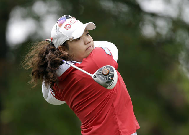 Ariya Jutanugarn, of Thailand, watches her tee shot on the ninth hole during the final round of the Kingsmill Championship LPGA golf tournament in Williamsburg, Va., Sunday, May 5, 2013.  (AP Photo/Steve Helber)
