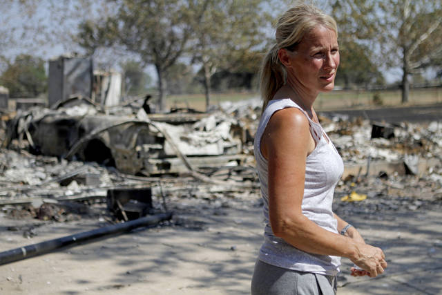 Steveanne Bielich stands by the remains of her home in northeast Oklahoma City, Wednesday, August 31, 2011. Bielich's home was destroyed by a wildfire on Tuesday, August 30, 2011. Photo by Bryan Terry, The Oklahoman