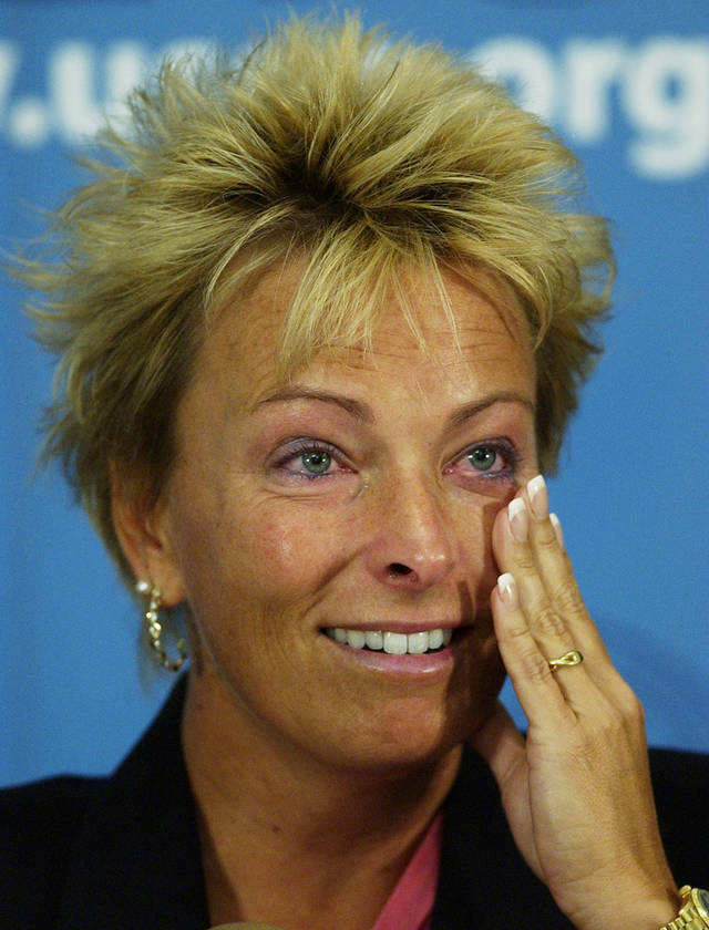 FILE - This July 1, 2004 file photo shows golfer Dottie Pepper wiping tears as she announces that she will retire as a player at a news conference during the first round of the U.S. Womens Open Golf Championship at The Orchards in South Hadley, Mass. Pepper learned the art of retirement at an early age. She announced her retirement at the 2004 U.S. Women's Open when she was 38. Her retirement Sunday, Dec. 16, 2012, after eight years with NBC Sports was not much different.  (AP Photo/Elise Amendola, File)