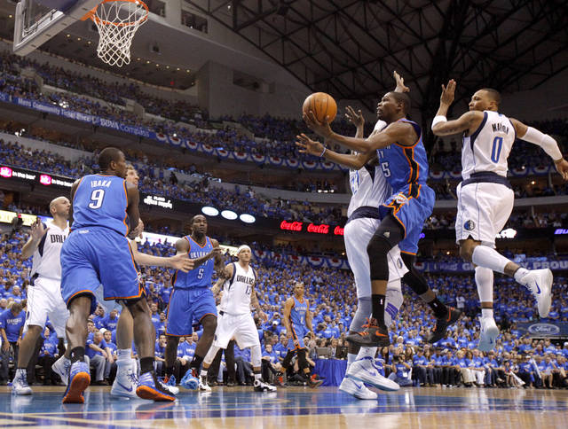 Oklahoma City&#039;s Kevin Durant (35) goes to the basket between Dallas&#039; Brendan Haywood (33) and Shawn Marion (0) during Game 3 of the first round in the NBA playoffs between the Oklahoma City Thunder and the Dallas Mavericks at American Airlines Center in Dallas, Thursday, May 3, 2012. Photo by Bryan Terry, The Oklahoman