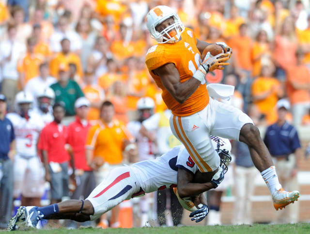 Tennessee wide receiver Jason Croom (18) makes a reception against South Alabama cornerback Tyrell Pearson (9) during the second half of an NCAA college football game at Neyland Stadium in Knoxville, Tenn. on Saturday, Sept. 28, 2013. (AP Photo/Knoxville News Sentinel, Adam Lau)