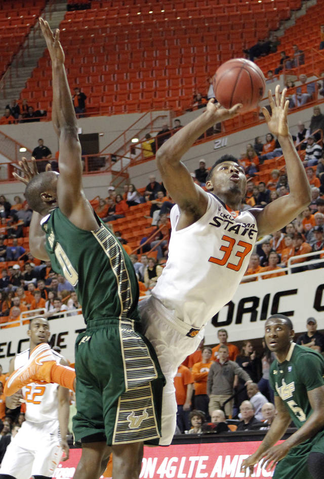Oklahoma State 's Marcus Smart (33) puts up a shot pst South Florida Bulls' Martino Brock (0) during the college basketball game between Oklahoma State University (OSU) and the University of South Florida (USF) on Wednesday , Dec. 5, 2012, in Stillwater, Okla.   Photo by Chris Landsberger, The Oklahoman