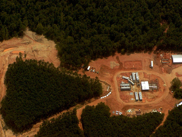 FILE - This is an August 2004 aerial file photo of the 200-acre site in Caddo Parish near Shreveport, La., where the first phase of construction on Chimp Haven is underway. The NIH Council of Councils Working Group on Tuesday Jan. 22, 2013 approved a proposal, which also calls for major cuts in grants to study chimps in laboratories and no return to breeding them for research. Government scientists have agreed that all but 50 of hundreds of chimpanzees kept for federally funded research should be retired from labs and sent to the national sanctuary.  (AP Photo/Chimp Haven, Naomi Lopez-Bauman)