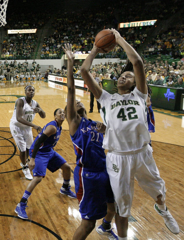 Baylor 's Brittney Griner (42) goes up for an attempt as Kansas 's Carolyn Davis (21) defends in the second half of an NCAA women's college basketball game Saturday, Jan. 28, 2012, in Waco, Texas. Griner had a game-high 28-points in the 74-46 Baylor win. (AP Photo/Tony Gutierrez)