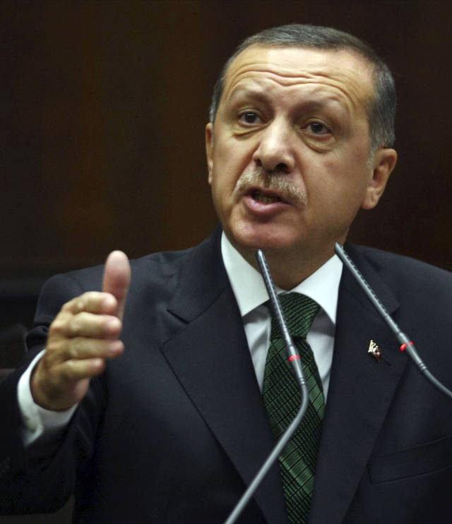 Turkish Prime Minister Recep Tayyip Erdogan addresses the legislators of his ruling party in parliament in Ankara, Turkey, Tuesday, Oct. 9, 2012. Erdogan said Turkey was prepared to counter any threats from Syria. �Every kind of threat to the Turkish territory and the Turkish people will find us standing against it,� Erdogan said. (AP Photo)