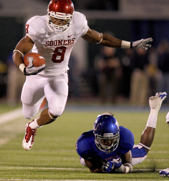 Oklahoma's Dominique Whaley (8) leaps past Kansas' Victor Simmons (27) during the college football game between the University of Oklahoma Sooners (OU) and the University of Kansas Jayhawks (KU) at Memorial Stadium in Lawrence, Kansas, Saturday, Oct. 15, 2011. Photo by Bryan Terry, The Oklahoman