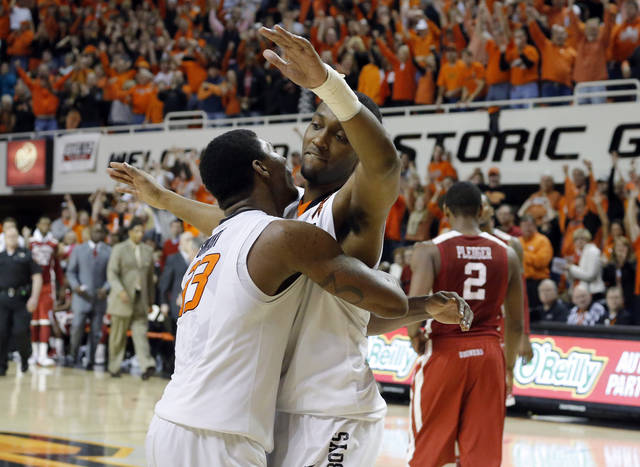 Oklahoma State's Marcus Smart (33) and Brian Williams (4)  celebrate in front of Oklahoma's Steven Pledger (2) at the end ofthe Bedlam men's college basketball game between the Oklahoma State University Cowboys and the University of Oklahoma Sooners at Gallagher-Iba Arena in Stillwater, Okla., Saturday, Feb. 16, 2013. Photo by Sarah Phipps, The Oklahoman