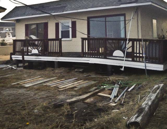 A Tuesday Dec. 4, 2012 photo shows the Bratek family cottage, which was damaged by Superstorm Sandy, in Brigantine, N.J.  Families that inherited small homes on the New Jersey shore over the years are trying to decide whether it is possible to repair or rebuild after Superstorm Sandy. (AP Photo/Katie Zezima)