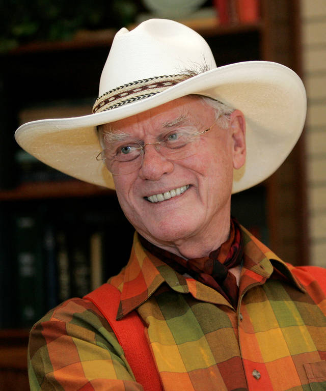 "FILE - In this Oct. 9, 2008 file photo, actor Larry Hagman responds to a question regarding his experience on the television show, ""Dallas"", at the Southfork Ranch in Parker, Texas. Hagman auctioned off many of his personal valuables Saturday June 4, 2011 in Beverly Hills.  Caroline Galloway of Julien's Auctions said a silver saddle was the priciest item sold, fetching $80,000.  (AP Photo/Tony Gutierrez, file) ORG XMIT: NY109"